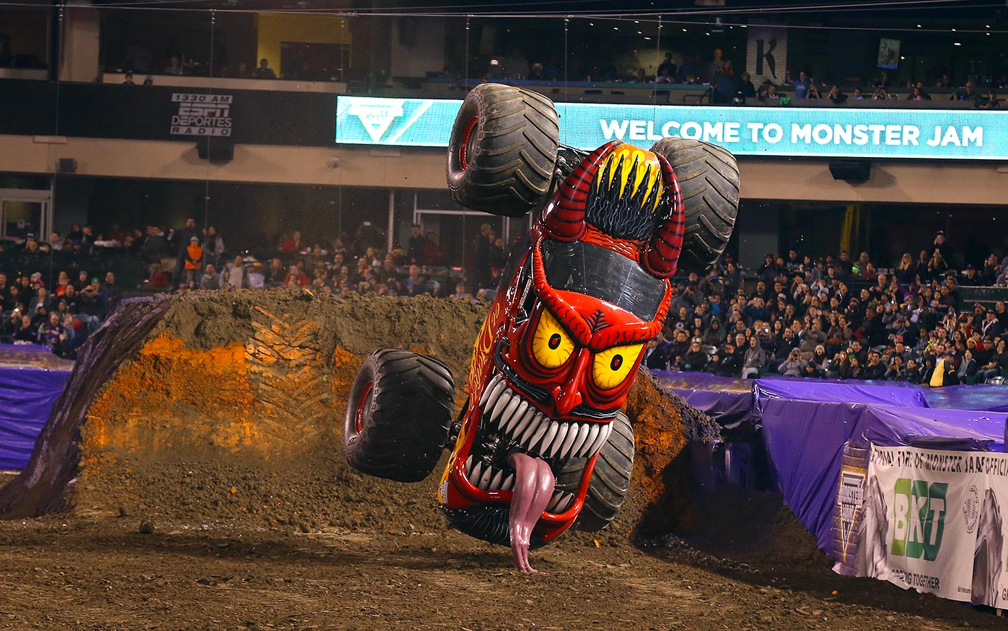 Sports Illustrated contributing photographer Gary Bogdon spent a day with Monster Trucks at Angel Stadium in Anaheim, Calif., during Monster Jam 2016. The over-sized trucks and their drivers compete on temporary dirt tracks in stadiums around the world.  Monster Truck El Diablo gets upright after doing a flip to the cheers of the crowd during freestyle competition .