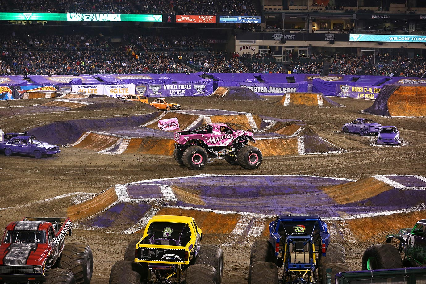 A fan favorite, Monster Truck 'Madusa' roars into the stadium to the cheers of the crowd.
