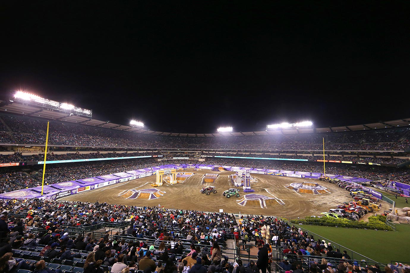 Grave Digger and Max-D hit the dirt track in front of a packed house at Angels Stadium.