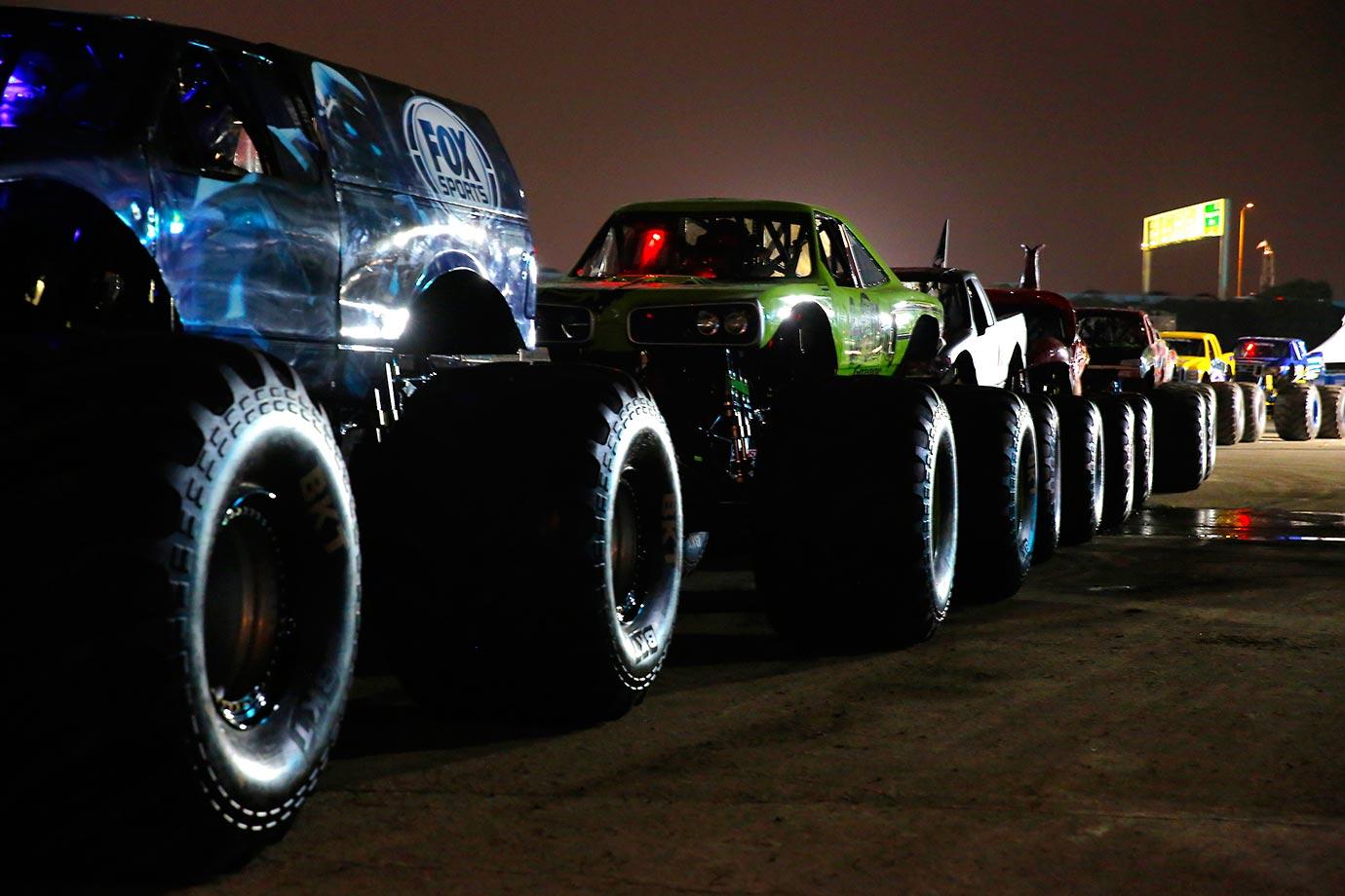 Monster Trucks line up to enter Angels Stadium for Monster Jam.