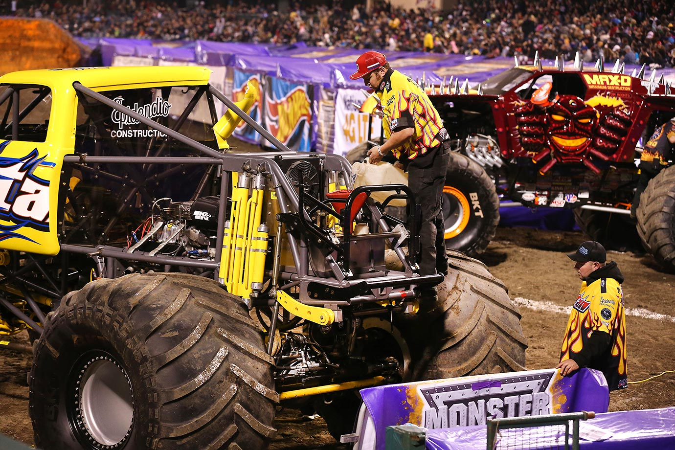 Members of Monster Truck 'TItan' crew fill the gas tank during a break in the competition.