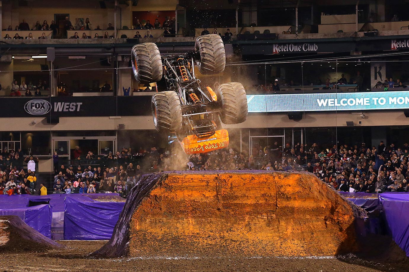 El Toro Loco excites the fans at Anaheim Stadium with a backflip.