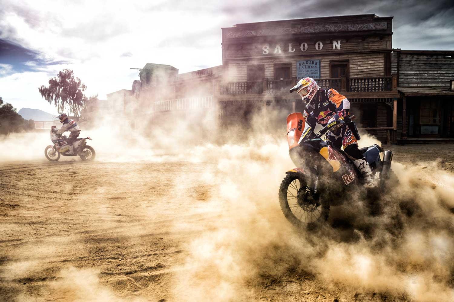 Francisco Chaleco Lopez and Ruben Faria take off in front of the saloon during an activation for Rally Dakar 2014.