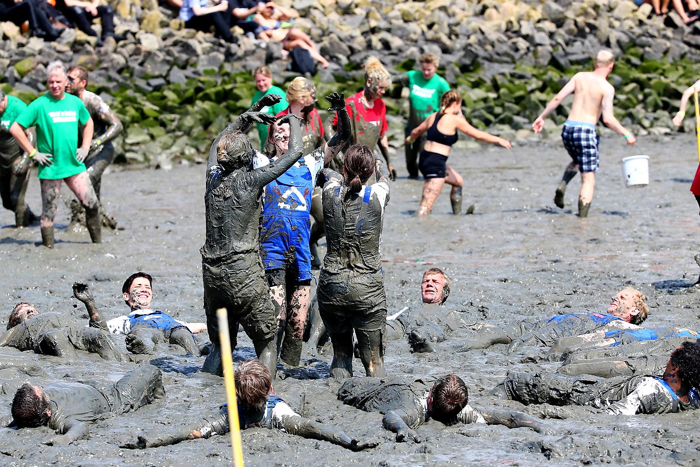 Participants during the Mudflat Olympic Games in Brunsbuettel, Germany.