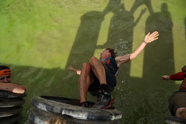 Murphy drops into water after completing Sewage Outlet obstacle during Tough Mudder's Beta Test Event.