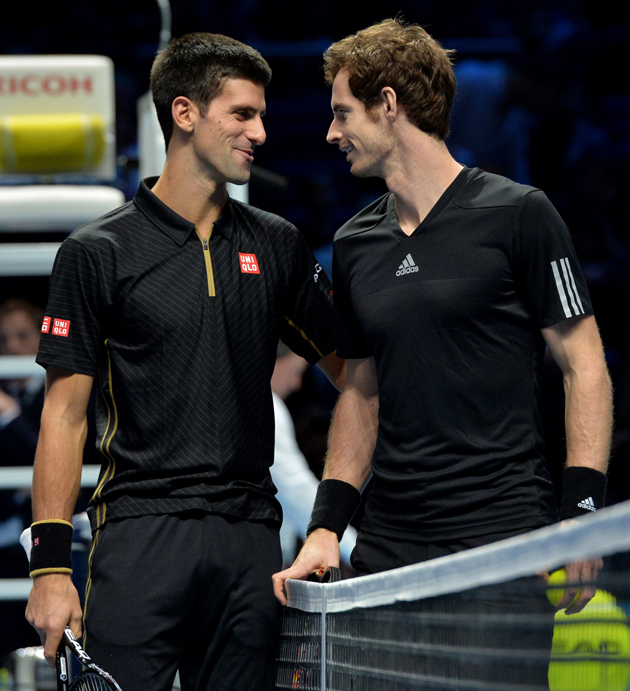 Djokovic and Murray share a moment before their exhibition match after Federer withdrew from the ATP Finals title match.