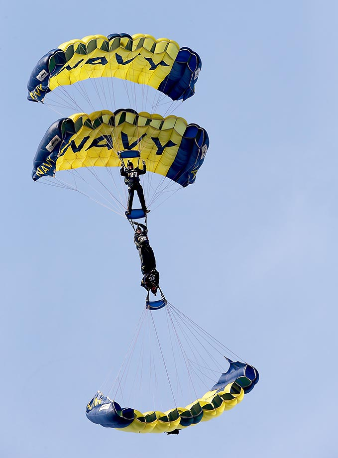 The Navy parachute team drops onto the the field before the Army-Navy game.