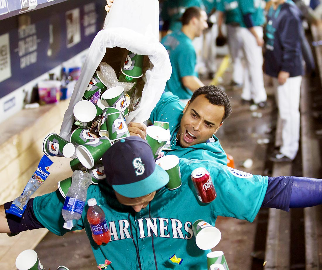 Mariners rightfielder Nelson Cruz empties a garbage can on top of Logan Morrison after the first baseman hit a walk-off homer against the A's to give Seattle a 4-3 win.