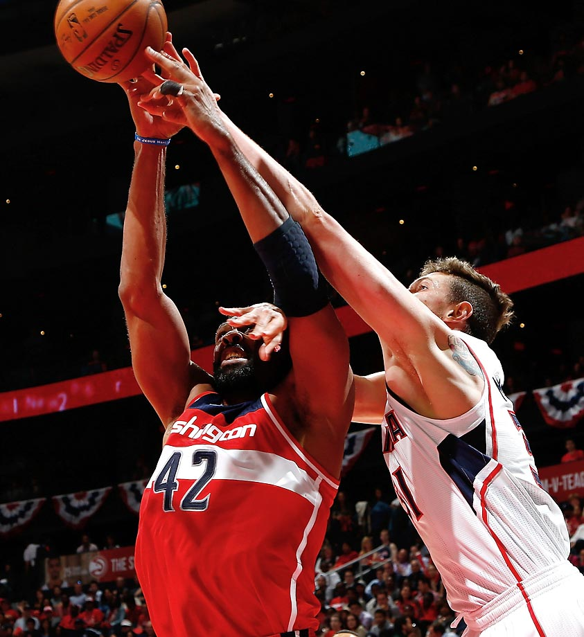 Wizards' Nene Hilario and Hawks' Mike Muscala.