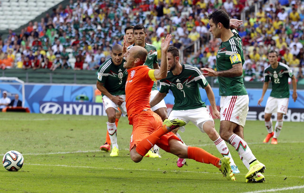 Netherlands star Arjen Robben draws a penalty on Mexico captain Rafa Marquez in the dying moments of the round-of-16 clash, giving the Dutch the chance to win it from the spot.