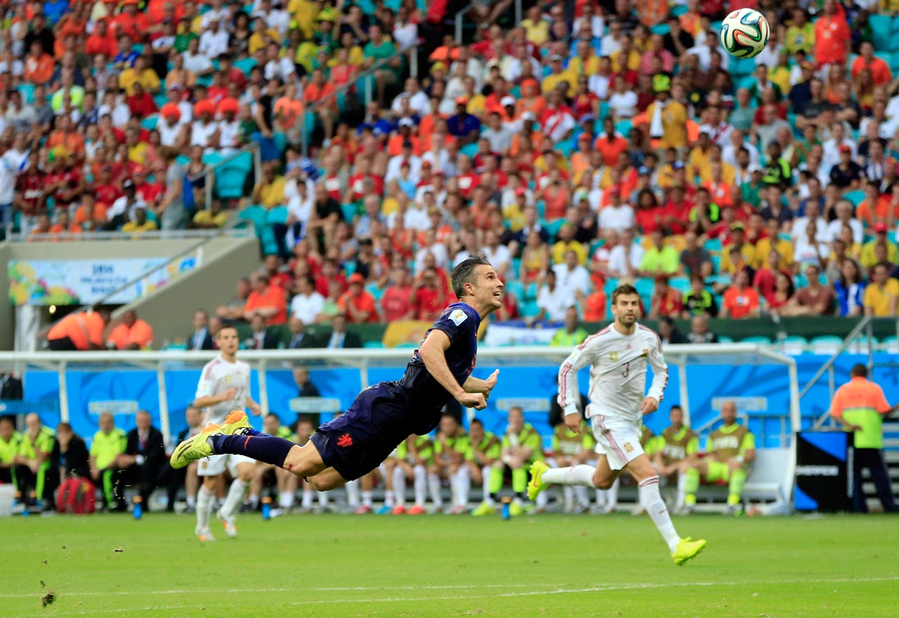 Robin van Persie latches onto Daley Blind's long cross with this diving header to beat Iker Casillas as part of the Netherlands' 5-1 win over Spain.