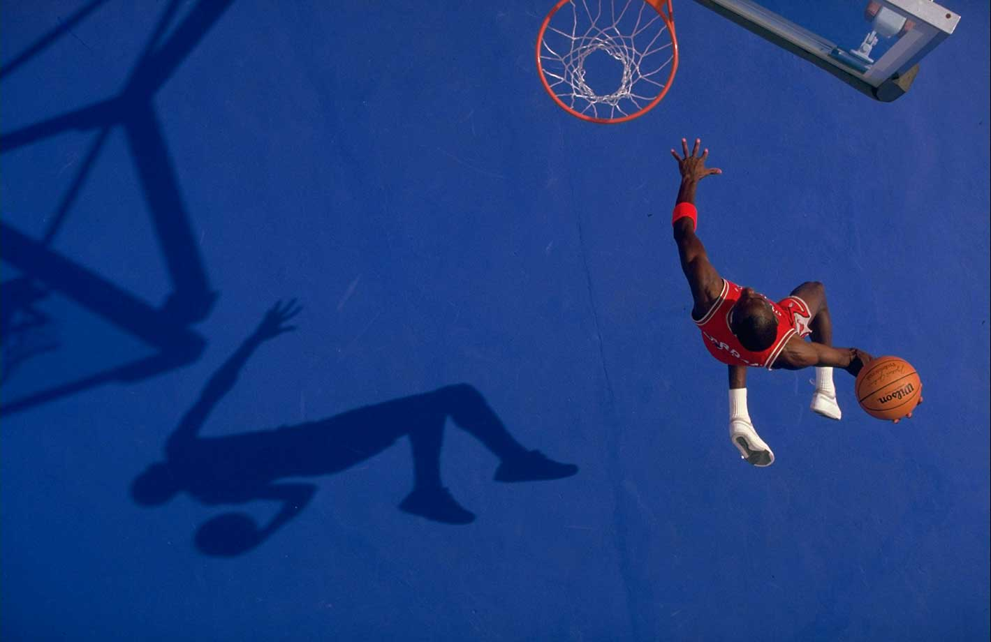Michael Jordan flies to the rim for a dunk in this 1987 action portrait.