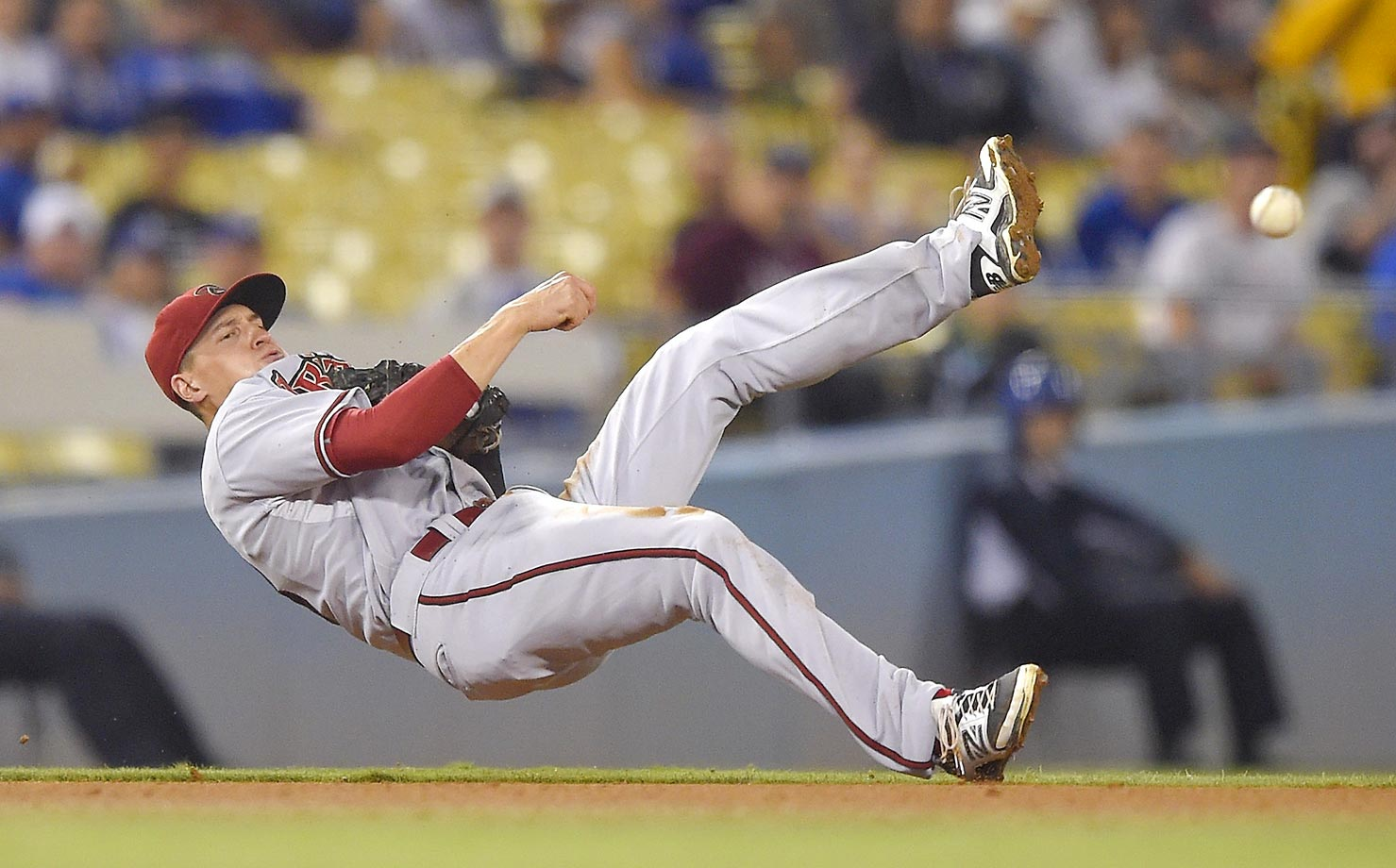 Nick Ahmed of the Arizona Diamondbacks makes the throw for the out against Chris Heisey of the Los Angeles Dodgers.
