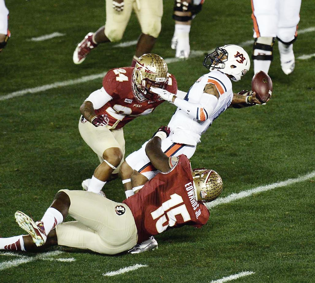Mario Edwards Jr. and Terrance Smith of Florida State tackle Nick Marshall of Auburn                   in the BCS Championship Game.