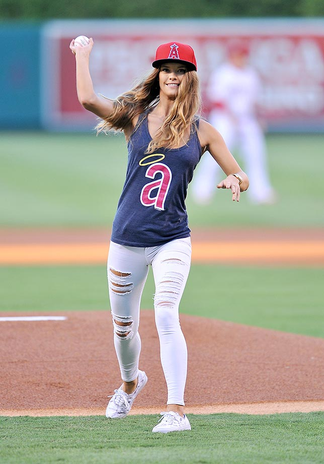 Sports Illustrated model Nina Agdal gets ready to throw out the first pitch before a game played between the Chicago White Sox and the Los Angeles Angels at Angel Stadium.