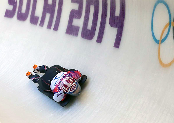 Noelle Pikus-Pace is second midway through the women's skeleton competition, .44 seconds off the lead.