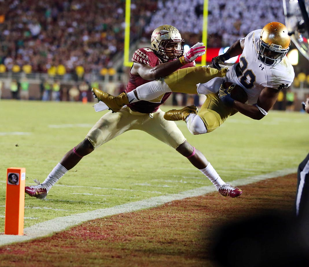 Florida State defensive back Jalen Ramsey breaks up a pass in the end zone intended for Notre Dame's C.J. Prossise. FSU won 31-27.