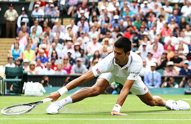 Novak Djokovic stretches to reach the ball against Radek Stepanek.