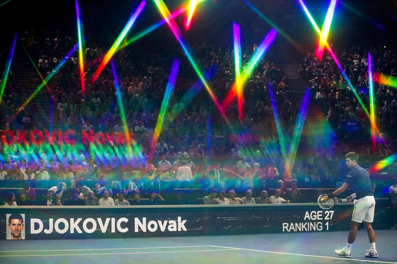 Crazy light effects surround Novak Djokovic during the BNP Paribas Masters Indoor 2014 in Paris.