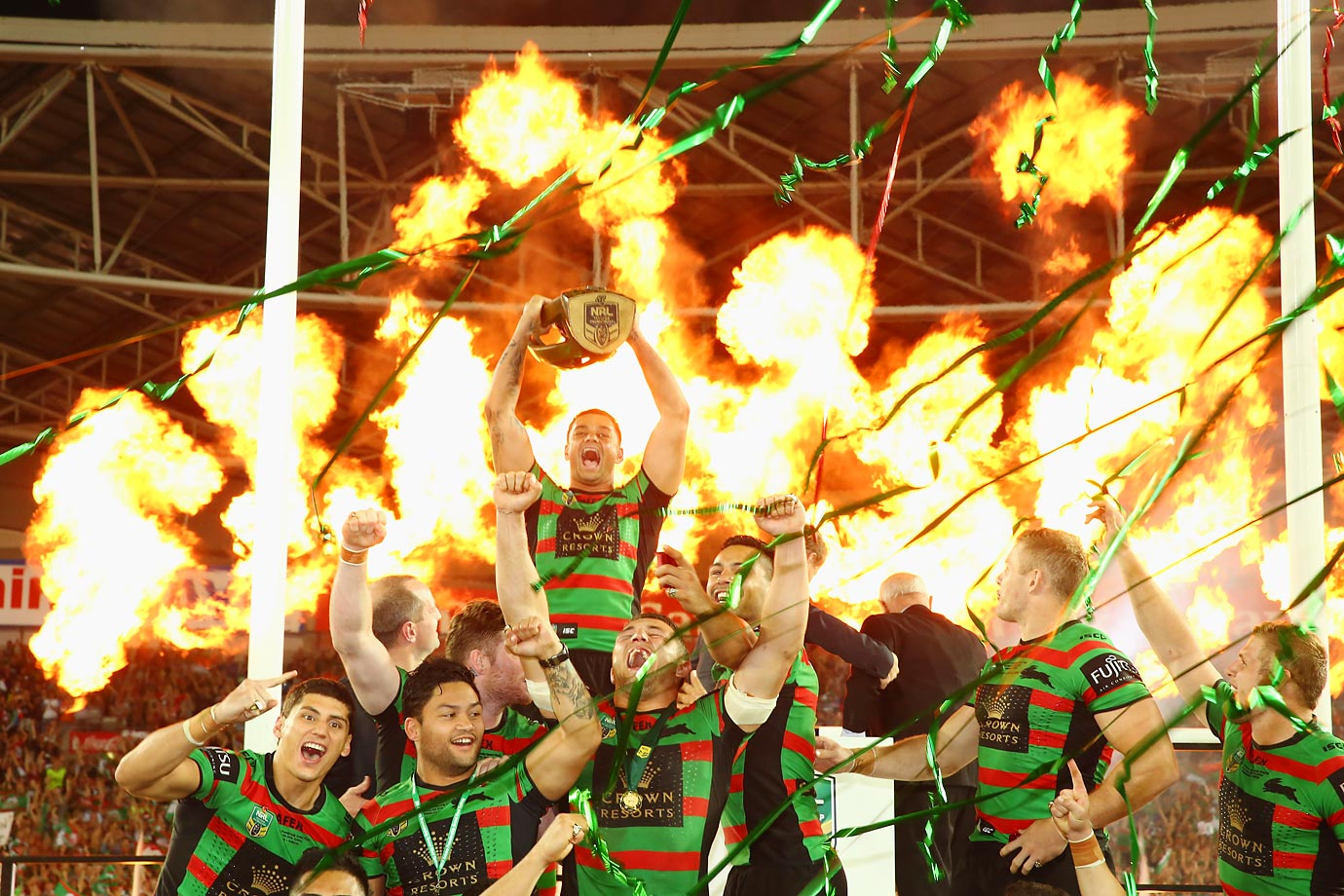 John Sutton lifts the trophy as the Rabitohs celebrate their victory during the 2014 NRL Grand Final match against the Canterbury Bulldogs.