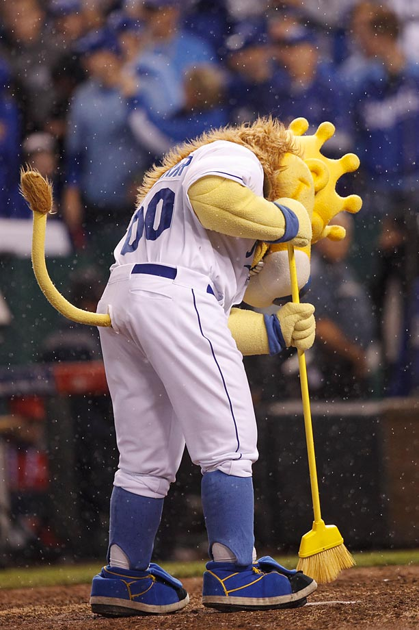 Kansas City mascot Sluggerrr sweeps home plate after the Royals defeated the Angels 8-3 and swept the American League Division Series.