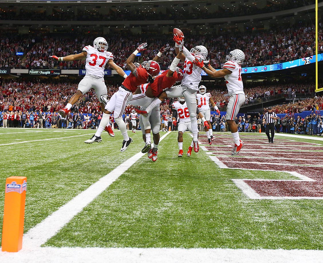 Ohio State safety Tyvis Powell intercepts the ball at the end of the Buckeyes' game against Alabama.
