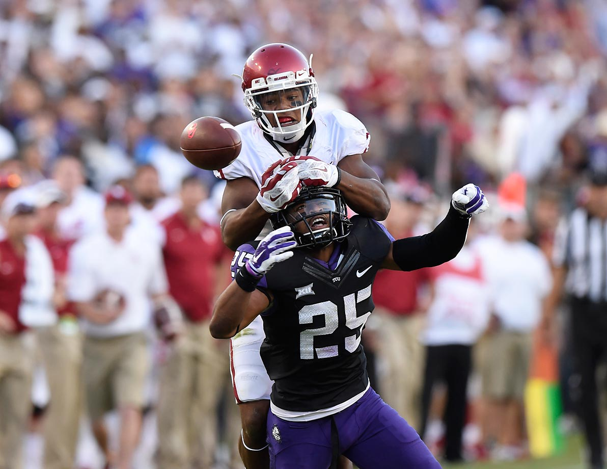 TCU cornerback Kevin White breaks up a pass intended for Oklahoma wide receiver Sterling Shepard.