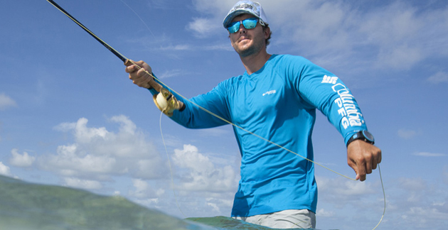 "A fisherman picture wearing Columbia's latest apparel featuring a ""special polymer"" that, when it touches moisture will swell and cool the surrounding fabric."