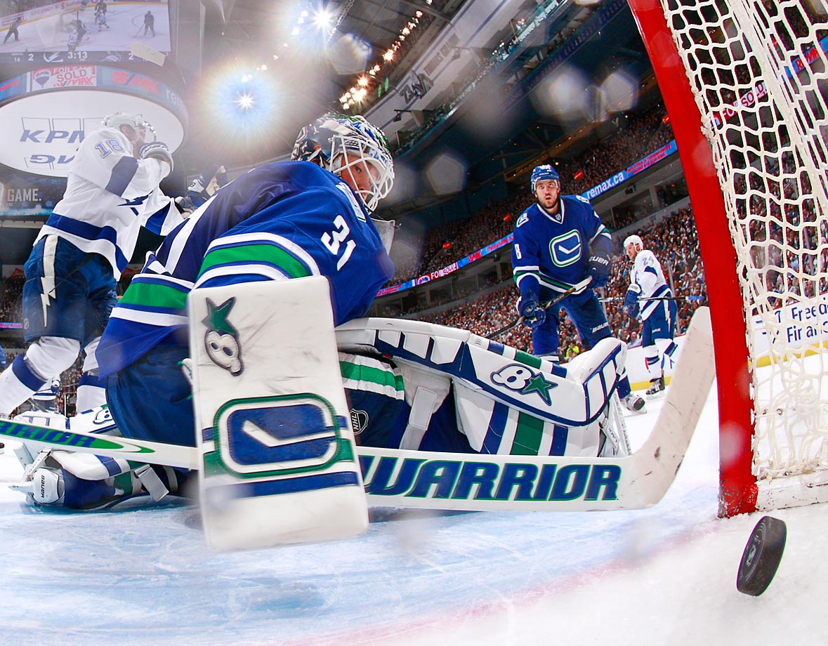 The Tampa Bay Lightning score a goal against Eddie Lack and the Vancouver Canucks. Tampa Bay won 4-2.