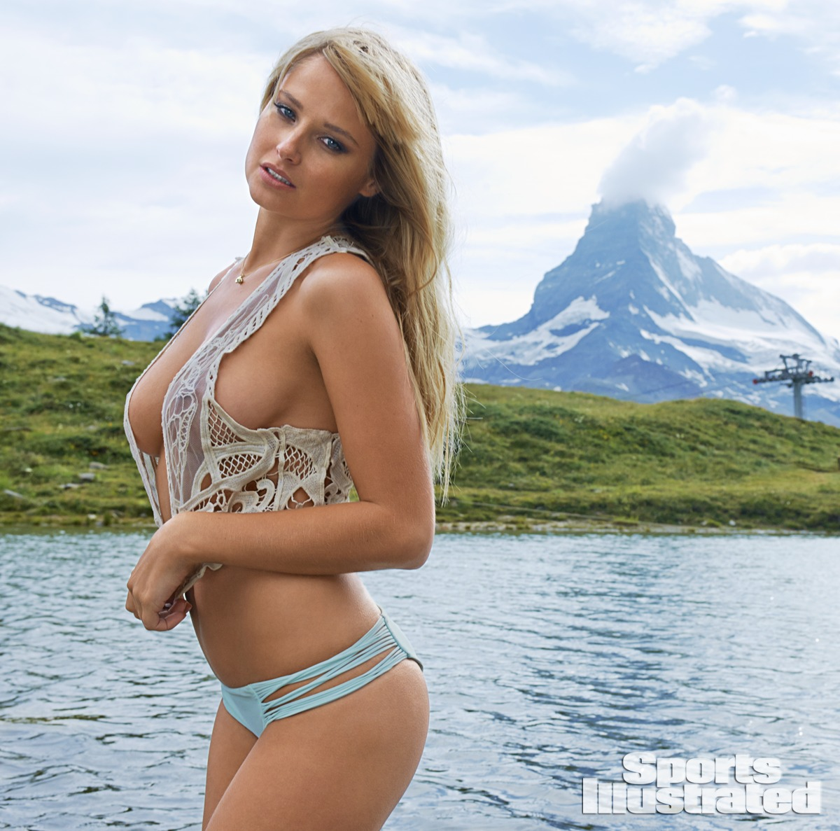 Genevieve Morton was photographed by Yu Tsai in Switzerland. Swimsuit by MIKOH, Top by Gabriela Dias.