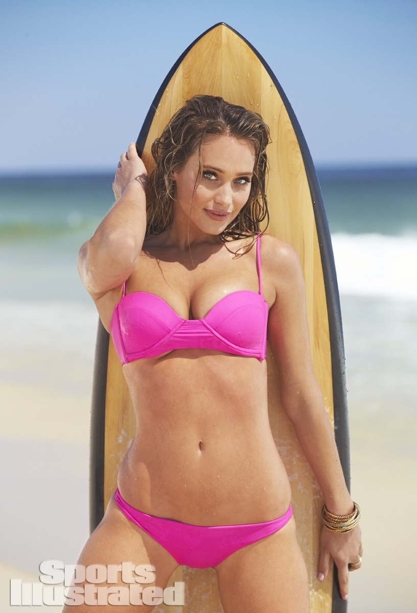 Hannah Davis was photographed by Ben Watts at the Jersey Shore. Swimsuit by Swimsuit by MIKOH; Surfboard by Grain Surfboards.