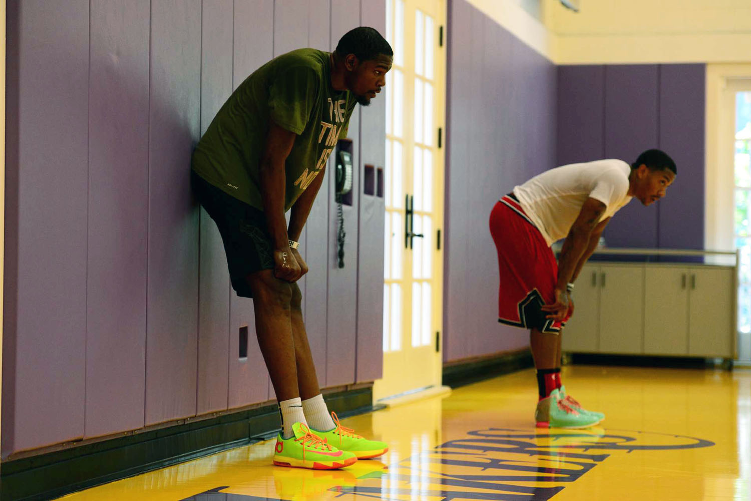 Kevin Durant and Derrick Rose take a breather during a training session with NBA trainer Rob McClanaghan.