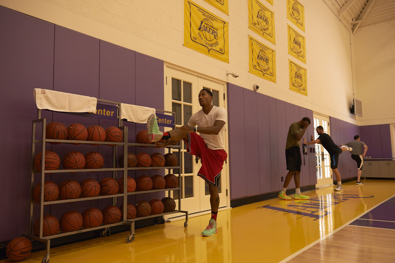 Derek Rose stretching before a practice session at the Toyota Sports Center with NBA trainer Rob McClanaghan.