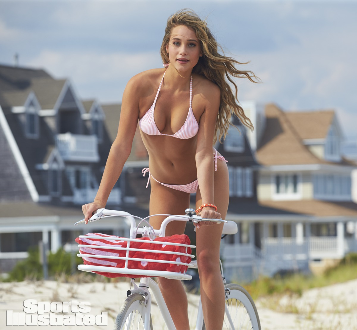 Hannah Davis was photographed by Ben Watts at the Jersey Shore. Swimsuit by Swimsuit by 2Chillies Swimwear.