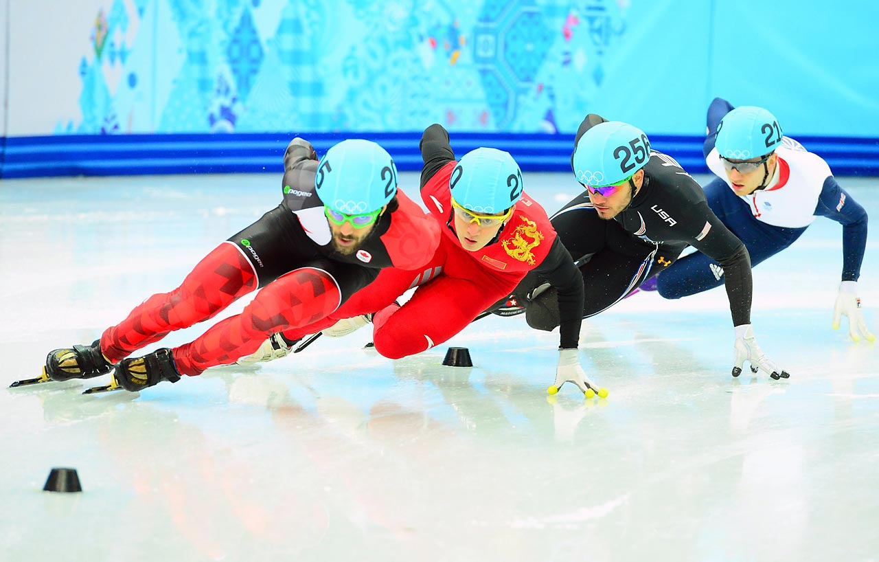 Charles Hamelin of Canada, Educardo Alvare of the U.S., Jack Whelbourne of Britian and Liang Wenhao of China.