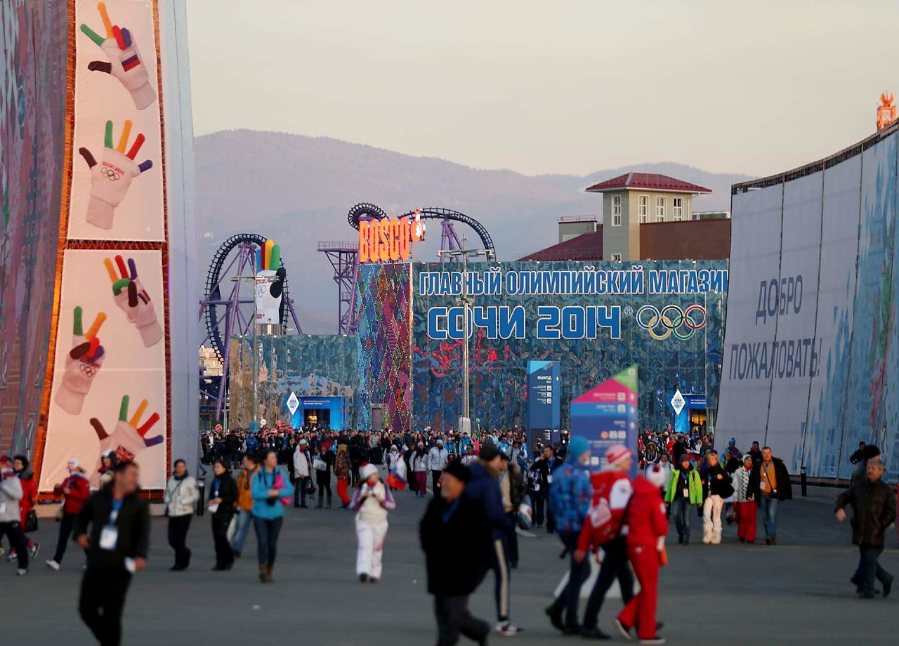 People stroll about before Friday's Opening Ceremonies.
