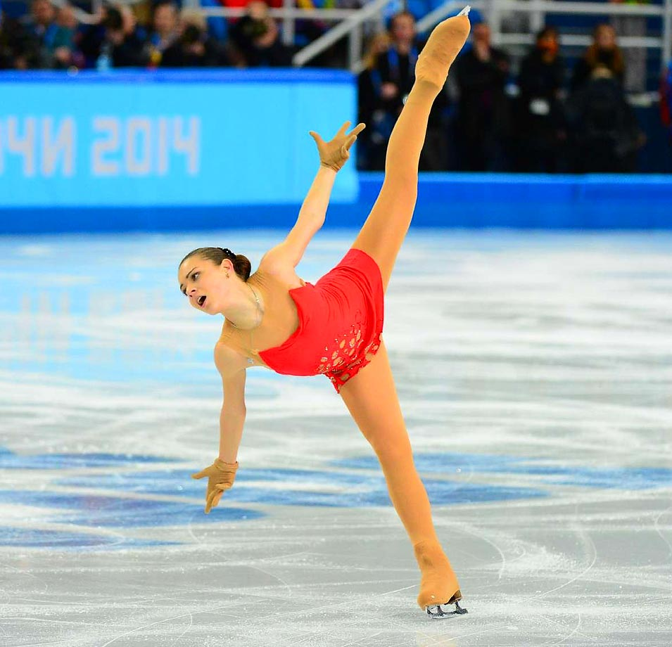 Adelina Sotnikova of Russia had the crowd on its feet before her final spin. Surprisingly, she heads into the second night of figure skating in second place.