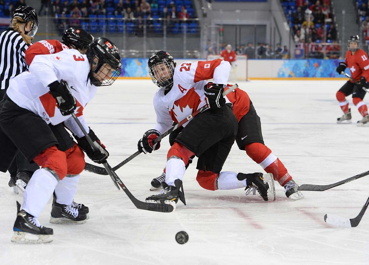 Natalie Spooner scored twice and Shannon Szabados stopped 21 shots to help the three-time defending gold medalists.