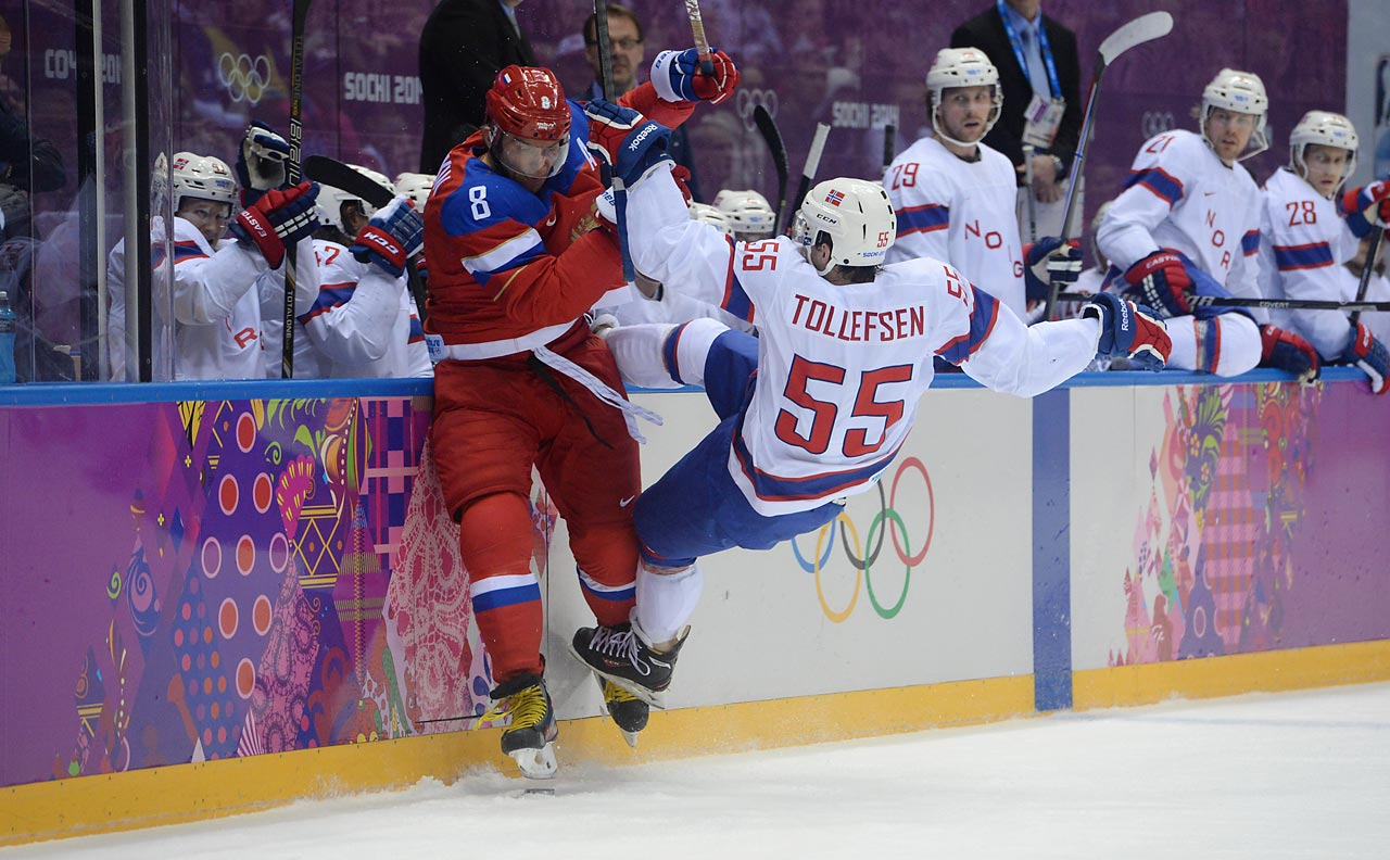 Alexander Ovechkin of Russia blasts Norway's Ole-Kristian Tollefsen to the ice during a 4-0 qualifying round victory for the Russians.