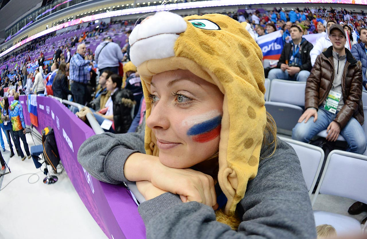 A Russian fan watches her country compete in the 2014 Sochi Games.
