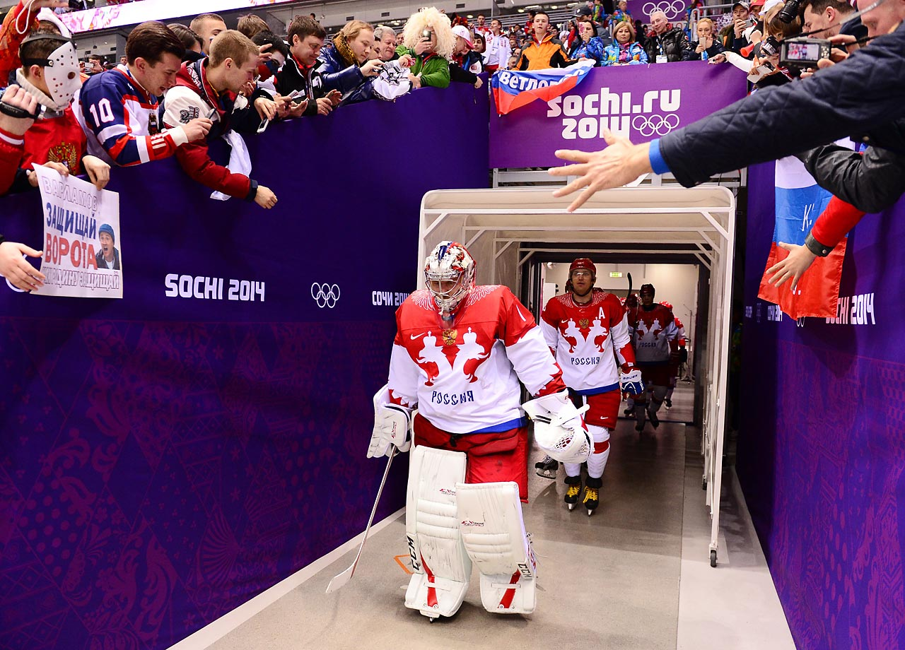 Semyon Varlamov leads Russia onto the ice for its game against Finland. In a shocker to the host country, the Russians lost 3-1.
