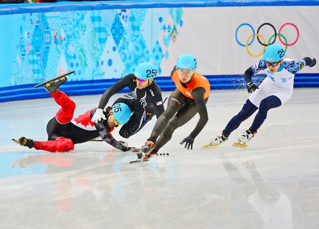 Eduardo Alvarez of the U.S. is taken down by Charles Hamelin of Canada in the 1000 meter.