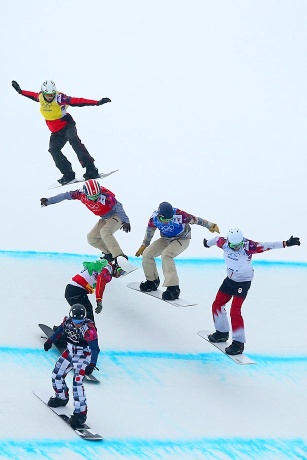 Riders jump during the small final of the men's snowboard cross competition in Sochi. Trevor Jacob of the United States (in red) competed despite hurting his ankle during a semifinal heat.