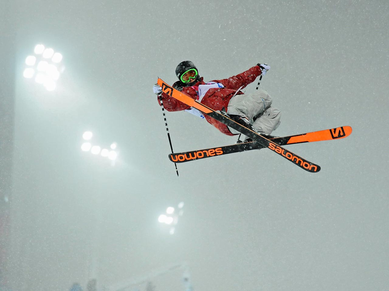 Canadian skier Mike Riddle flies through the air during the ski halfpipe qualification.