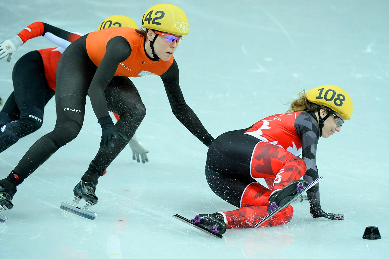 Marianne St-Gelais of Canada crashes during the 1,000 meter short track speedskating competition.