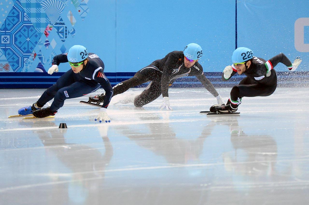 American speedskater Eduardo Alvarez crashes during the 500 meter competition.
