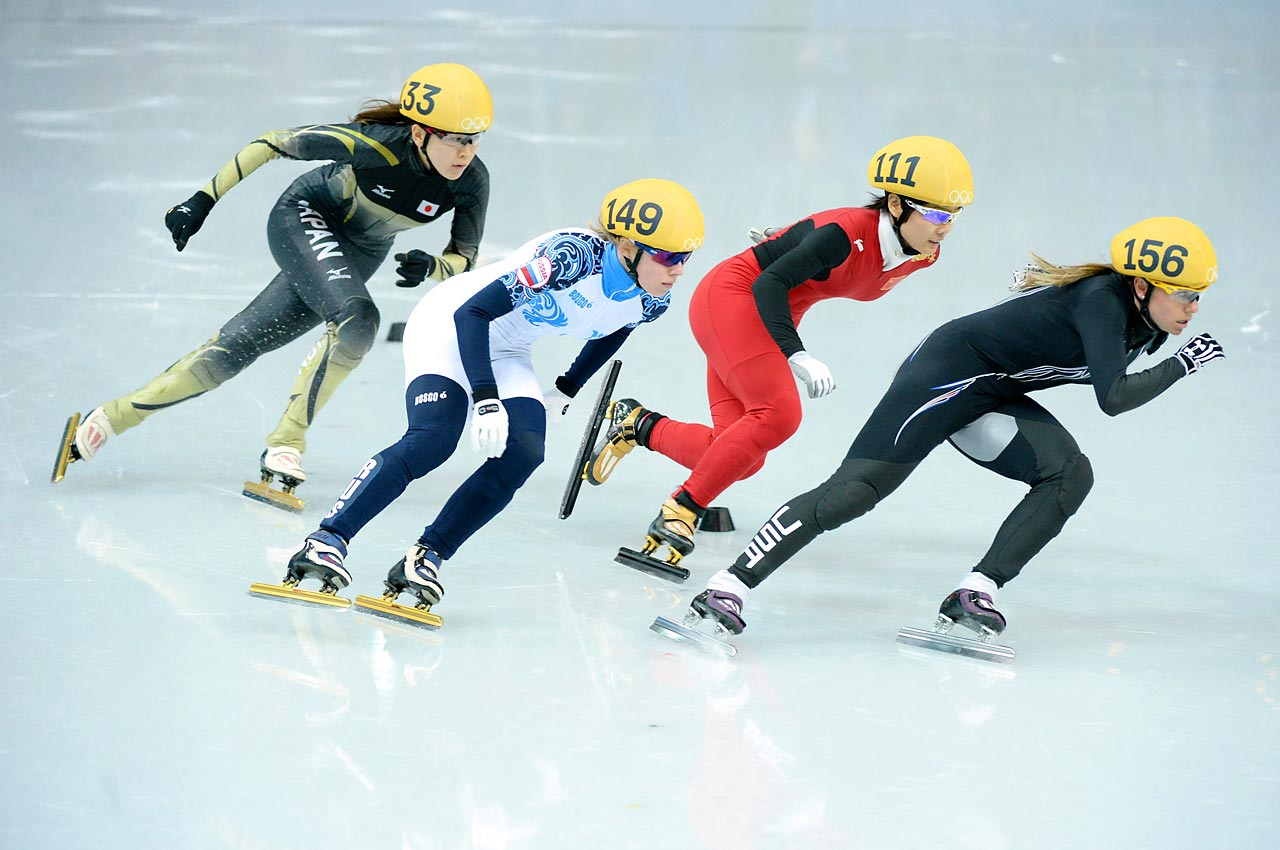 Speedskaters race around the track during the first heat of the 1,000 meter short track competition. American competitor Jessica Smith (right) finished second in the heat and qualified for Friday's quarterfinal competition.