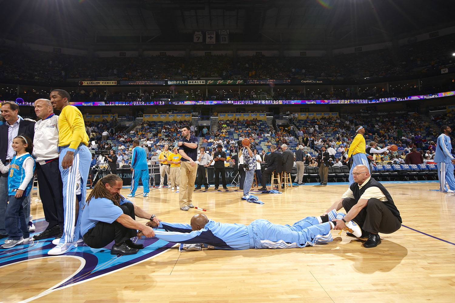 Denver's Chauncey Billups being stretched out by trainers before a game against the New Orleans Hornets in 2009.