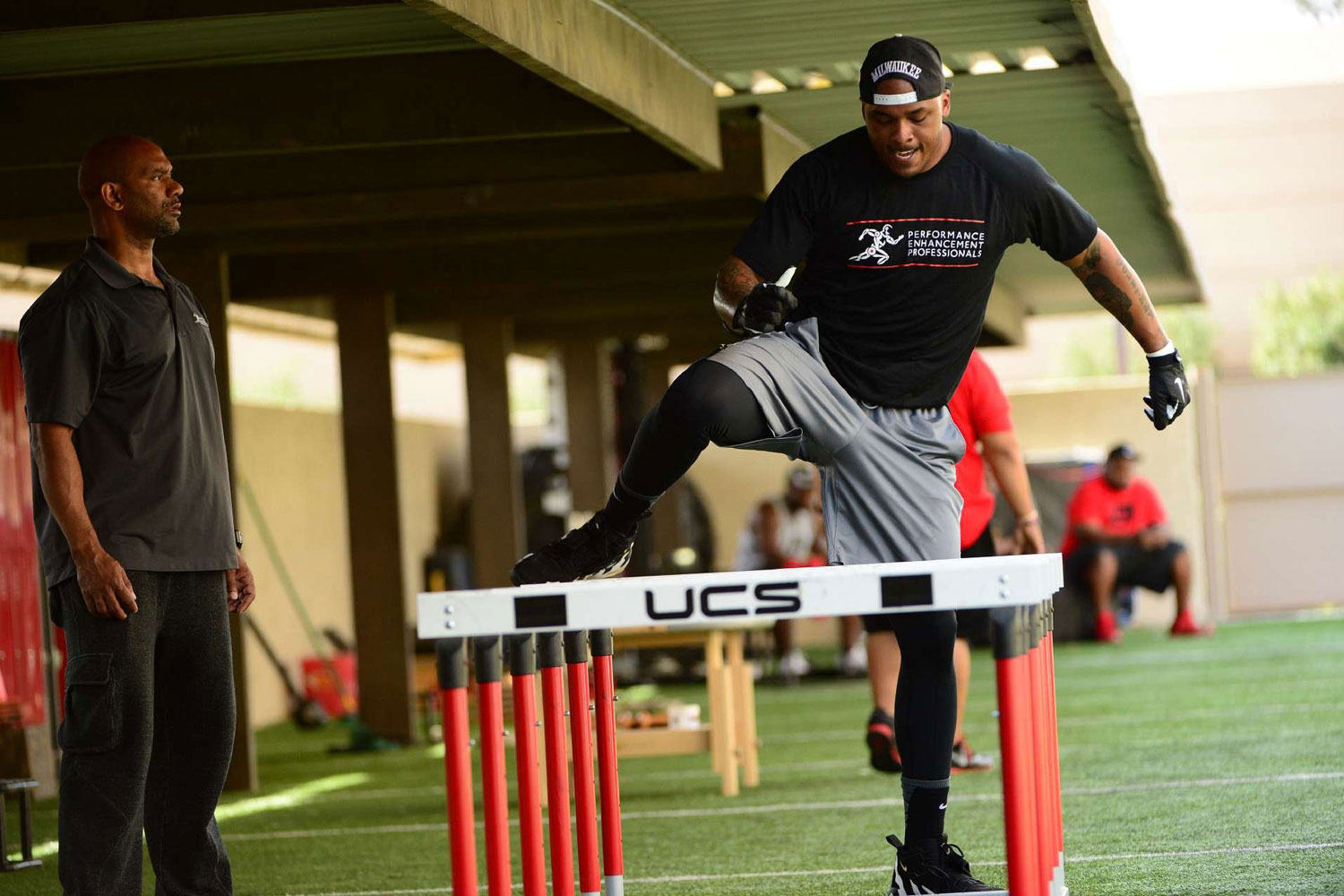 Green Bay Packers tight end Jermichael Finley running hurdles at the Performance Enhancement Professionals complex in Scottsdale, AZ in February 2014.