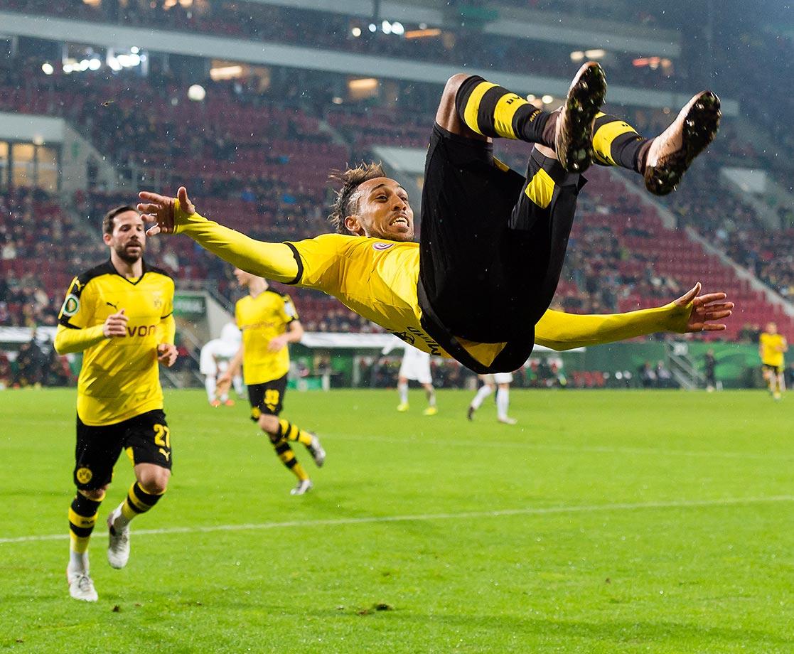 Pierre-Emerick Aubameyang of Borussia Dortmund celebrates after scoring the opening goal against FC Augsburg.